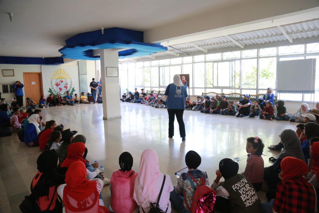 Niños refugiados en una sesión de asistencia psicosocial
