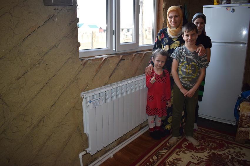 Market Usumova con sus hijos